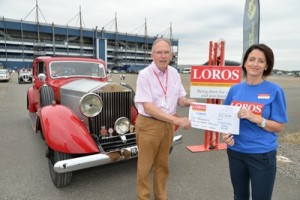 Andrew Duerden hands over £2,500 to Debbie Dickman of Loros before the start of the Welland Valley Wander from Rockingham Speedway. PICTURE: ANDREW CARPENTER